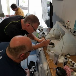 Help for Heroes beneficiares passing on their new airbrush skills